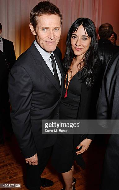 Willem Dafoe and Giada Colagrande attend the 'Foxcatcher' party hosted by Annapurna at Baoli Beach during the 67th Cannes Film Festival on May 19...