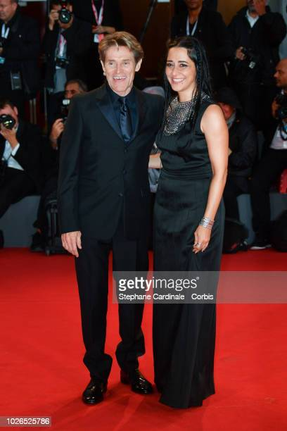 Willem Dafoe and Giada Colagrande walk the red carpet ahead of the 'At Eternity's Gate' screening during the 75th Venice Film Festival at Sala Grande...