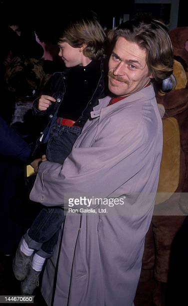 "Willem Dafoe and son Jack Dafoe attend the premiere of ""Oliver and Company"" on November 13, 1988 at the Ziegfeld Theater in New York City."