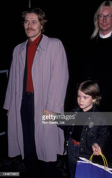 Willem Dafoe and son Jack Dafoe attend the premiere of Oliver and Company on November 13 1988 at the Ziegfeld Theater in New York City