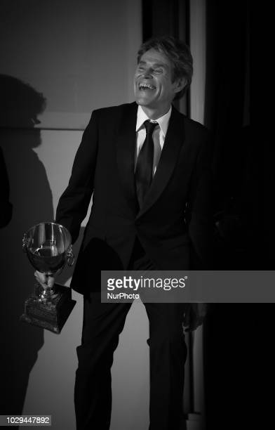 Image has been converted to black and white Willem Dafoe poses with the Coppa Volpi for Best Actor for 'At Eternity's Gate' at the Winners Photocall...