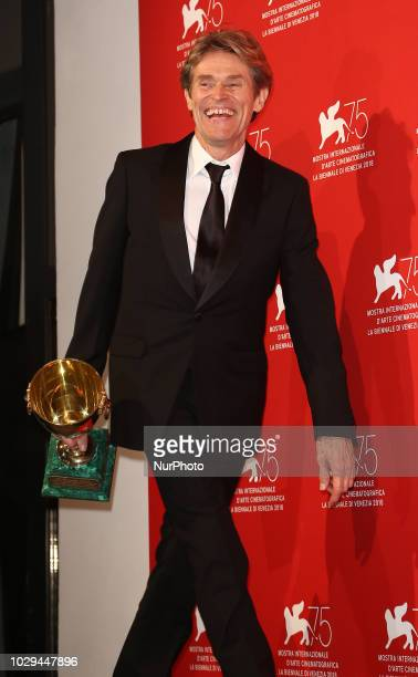 Willem Dafoe poses with the Coppa Volpi for Best Actor for 'At Eternity's Gate' at the Winners Photocall during the 75th Venice Film Festival on...