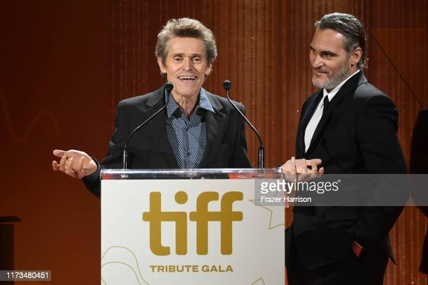 Willem Dafoe presents the TIFF Tribute Actor Award to Joaquin Phoenix onstage during the 2019 Toronto International Film Festival TIFF Tribute Gala...