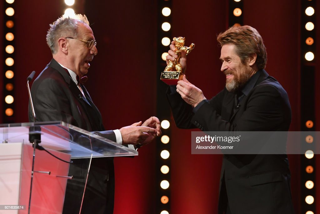 Willem Dafoe (R) receives the Honorary Golden Bear from Festival director Dieter Kosslick at the Homage Willem Dafoe - Honorary Golden Bear award ceremony and 'The Hunter' screening during the 68th Berlinale International Film Festival Berlin at Berlinale Palast on February 20, 2018 in Berlin, Germany.