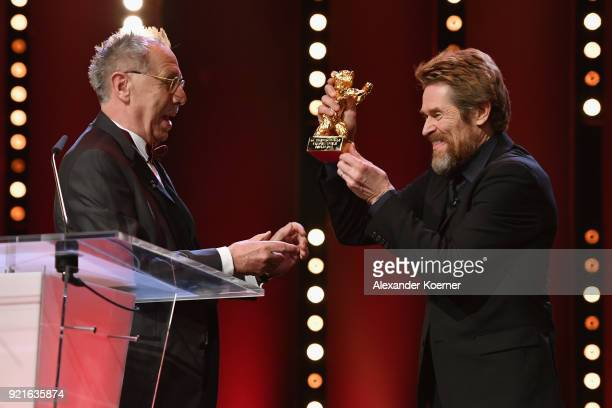 Willem Dafoe receives the Honorary Golden Bear from Festival director Dieter Kosslick at the Homage Willem Dafoe Honorary Golden Bear award ceremony...
