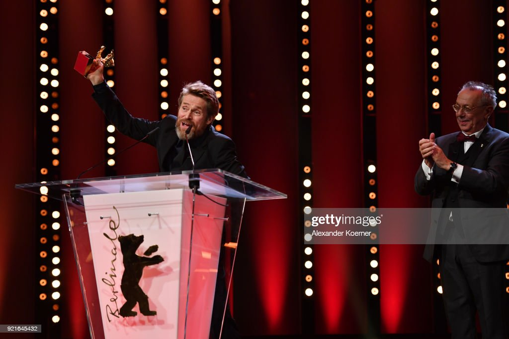 Willem Dafoe (L) receives the Honorary Golden Bear from Festival director Dieter Kosslick at the Homage Willem Dafoe - Honorary Golden Bear award ceremony and 'The Hunter' screening during the 68th Berlinale International Film Festival Berlin at Berlinale Palast on February 20, 2018 in Berlin, Germany.