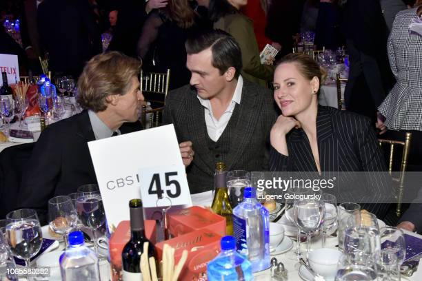 Willem Dafoe Rupert Friend and Aimee Mullins attend the 2018 IFP Gotham Awards with FIJI Water at Cipriani Wall Street on November 26 2018 in New...