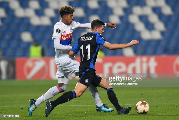 Willem Geubbels of Olympique Lyon competes for the ball whit Remo Freuler of Atalanta during the UEFA Europa League group E match between Atalanta...