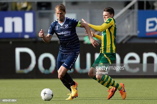 Willem Janssen of FC Utrecht Danny Bakker of ADO Den Haag during the Dutch Eredivisie match between ADO Den Haag and FC Utrecht at Kyocera stadium on...