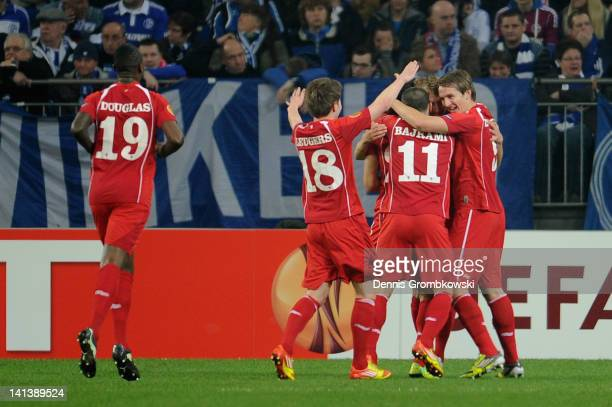 Willem Janssen of Twente celebrates with teammates after scoring his team's opening goal during the UEFA Europa League Round of 16 second leg match...