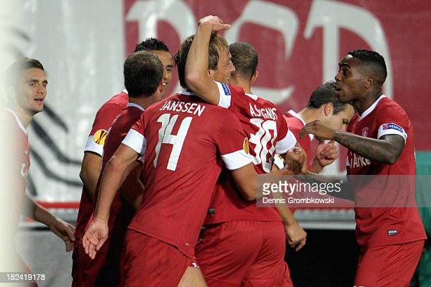 Willem Janssen of Twente celebrates with teammates after scoring his team's first goal during the UEFA Europa League Group L match between Twente...
