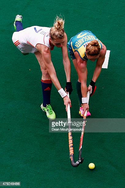 Willemijn Bos of the Netherlands battles for the ball with Georgia Nanscawen of Australia during the Fintro Hockey World League SemiFinal match...