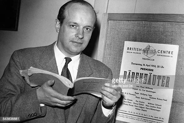 Willems Paul Playwright BelgiumPortrait in front of a placard announcing the premiere of his play 'Der Baerenhaeuter' in Berliin Photographer...