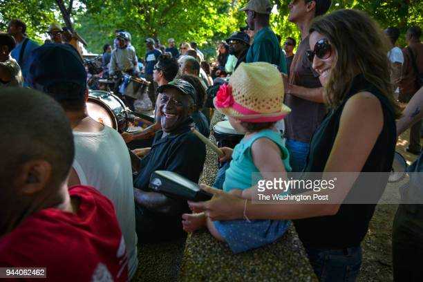 WASHINGTON DC JUNE Willey Posey C greets Maria Leoni and her daughter Julia BeitlerLeoni during the Summer season's weekly African drum circle at...