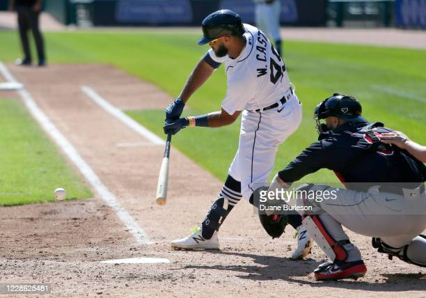 Willi Castro of the Detroit Tigers strikes out with catcher Sandy Leon of the Cleveland Indians behind the plate during the third inning at Comerica...