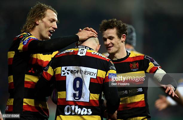 Willi Heinz of Gloucester celebrates with team mates Billy Twelvetrees and Billy Burns after scoring a try during the European Rugby Challenge Cup...