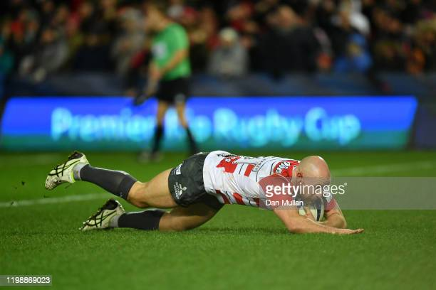 Willi Heinz of Gloucester dives over to score his side's first try during the Heineken Champions Cup Round 5 match between Gloucester Rugby and...