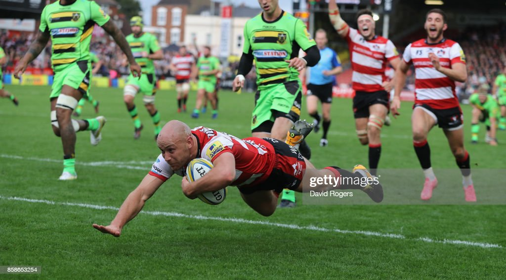 Willi Heinz of Gloucester dives to score their fifth try during the Aviva Premiership match between Gloucester Rugby and Northampton Saints at Kingsholm Stadium on October 7, 2017 in Gloucester, England.