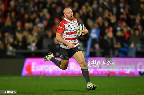 Willi Heinz of Gloucester m makes a break to score his side's first try during the Heineken Champions Cup Round 5 match between Gloucester Rugby and...