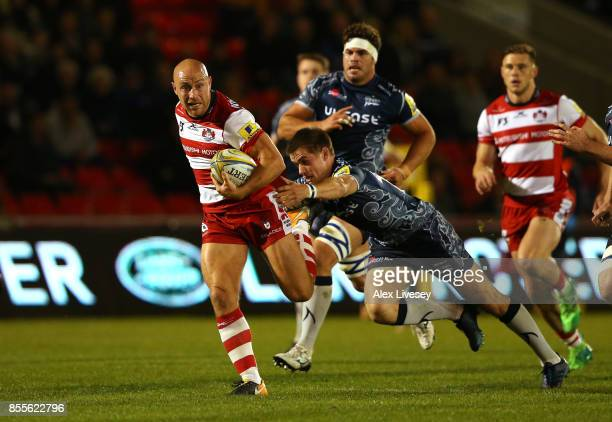 Willi Heinz of Gloucester Rugby is tackled by AJ MacGinty of Sale Sharks during the Aviva Premiership match between Sale Sharks and Gloucester Rugby...