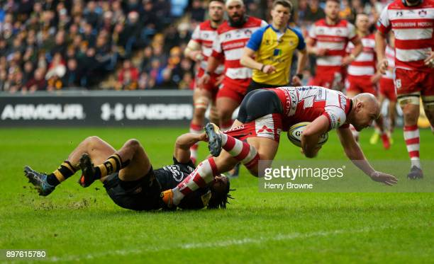 Willi Heinz of Gloucester scores their first try despite the efforts of Kyle Eastmond of Wasps during the Aviva Premiership match between Wasps and...