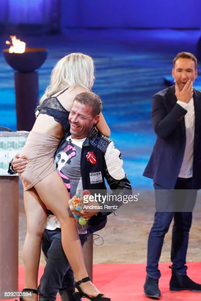 Willi Herren lifts-up Evelyn Burdecki during the finals of 'Promi Big Brother 2017' at MMC Studio on August 25, 2017 in Cologne, Germany.