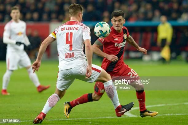 Willi Orban of Leipzig and Charles Aranguiz of Leverkusen battle for the ball during the Bundesliga match between Bayer 04 Leverkusen and RB Leipzig...