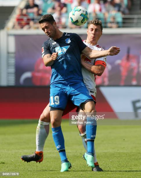 Willi Orban of Leipzig battles for the ball with Mark Alexander Uth of Hoffenheim during the Bundesliga match between RB Leipzig and TSG 1899...