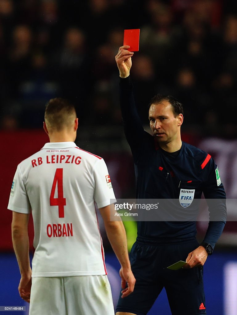 Willi Orban of Leipzig is sent off by referee Bastian Dankert during the Second Bundesliga match between 1. FC Kaiserslautern and RB Leipzig at Fritz-Walter-Stadion on April 25, 2016 in Kaiserslautern, Germany.