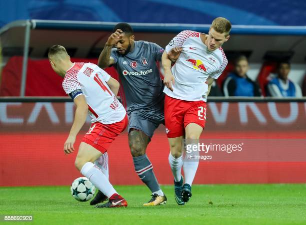 Willi Orban of Leipzig Marcel Halstenberg of Leipzig and Jeremain Lens of Besiktas battle for the ball during the UEFA Champions League group G...