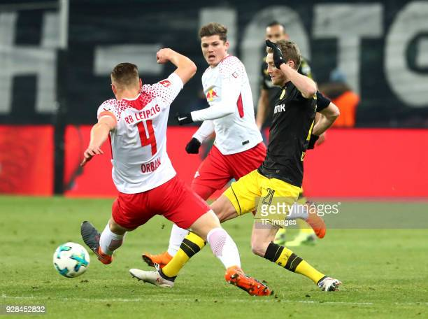 Willi Orban of Leipzig Marcel Sabitzer of Leipzig and Andre Schuerrle of Dortmund battle for the ball during the Bundesliga match between RB Leipzig...