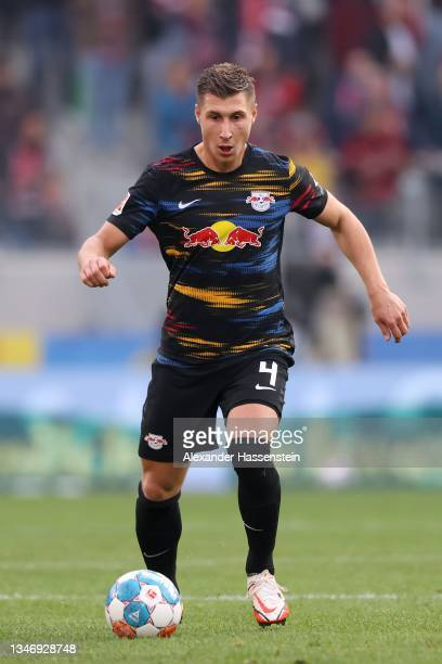 Willi Orban of Leipzig runs with the ball during the Bundesliga match between Sport-Club Freiburg and RB Leipzig at Europa Park Stadion on October...