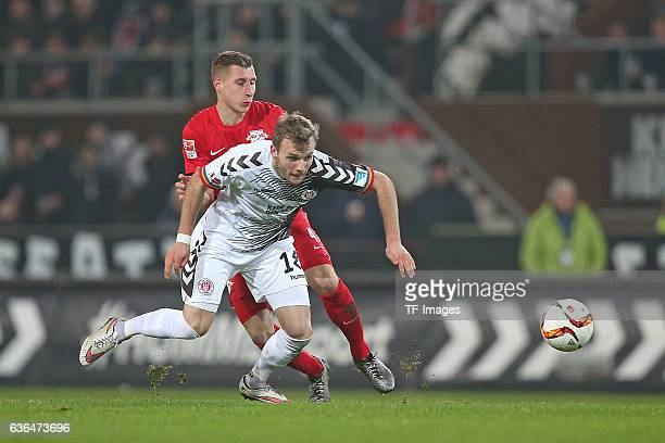 Willi Orban of RB Leipzig and Lennart Thy of St Pauli battle for the ball during the Second Bundesliga match between FC St Pauli and RasenBallsport...