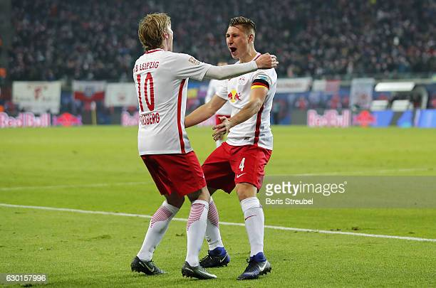 Willi Orban of RB Leipzig celebrates with team mate Emil Forsberg of RB Leipzig after scoring his team's second goal during the Bundesliga match...