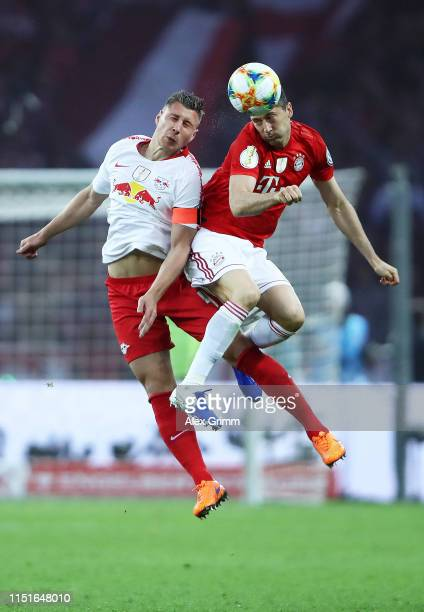 Willi Orban of RB Leipzig competes for a header with Robert Lewandowski of Bayern Munich during the DFB Cup final between RB Leipzig and Bayern...