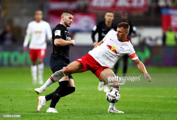 Willi Orban of RB Leipzig is challenged by Luka Jovic of Eintracht Frankfurt during the Bundesliga match between Eintracht Frankfurt and RB Leipzig...
