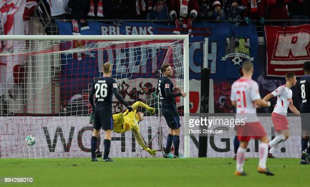 Willi Orban of RB Leipzig scores his team's first goal against goalkeeper Rune Jarstein of Hertha BSC during the Bundesliga match between RB Leipzig...