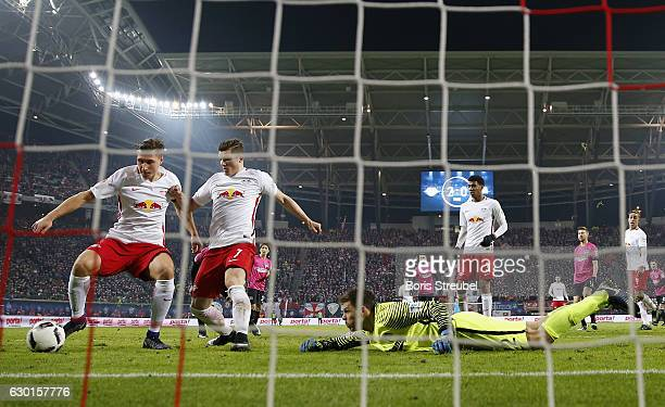Willi Orban of RB Leipzig tries to score against goalkeeper Rune Jarstein of Hertha BSC during the Bundesliga match between RB Leipzig and Hertha BSC...