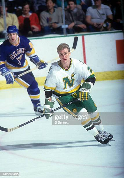 Willi Plett of the Minnesota North Stars skates on the ice during an NHL game against the St Louis Blues circa 1985 at the Met Center in Bloomington...