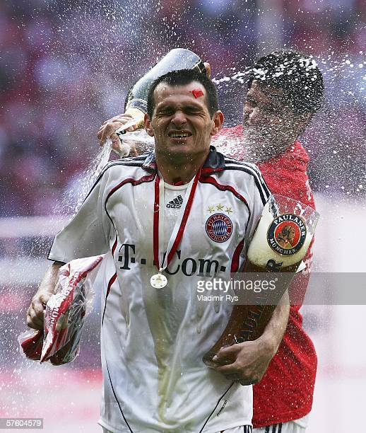 Willi Sagnol of Bayern gets a beer shower from his team mate Michael Ballack during the celebrations after the Bundesliga match between FC Bayern...