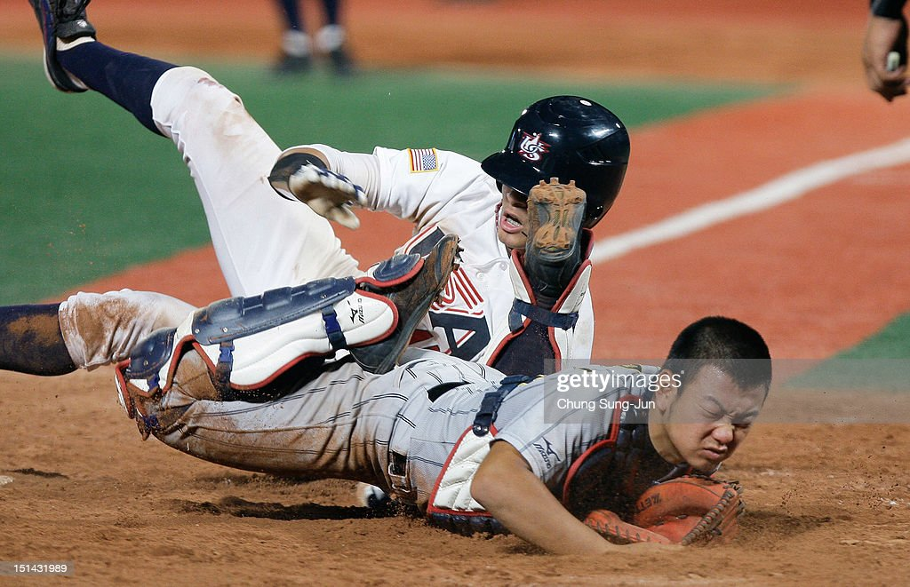 William Abreu of THE United States slides safely into home and scores a run past catcher Tomoya Mori of Japan in the seventh inning during the U18 Baseball World Championship match between Japan and the United States at Mokdong Stadium on September 7, 2012 in Seoul, South Korea.