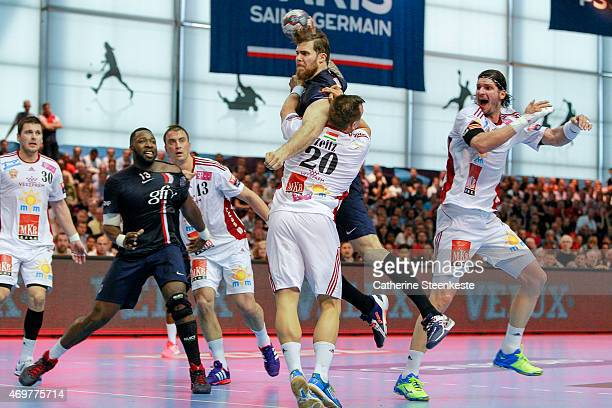 William Accambray of Paris SaintGermain Handball tries to shoot the ball against Christian Zeitz of MKBMVM Veszprem during the EHF Men's Champions...