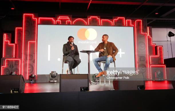 william and A J Calloway speak onstage during A Fireside Chat with william at the Mastercard House Presented By IAMPLUS at Mastercard House on...
