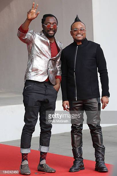 Will.i.am and Apl.de.ap of the Black Eyed Peas arrive at the 2011 Mnet Asian Music Awards at the Singapore Indoor Stadium on November 29, 2011 in...
