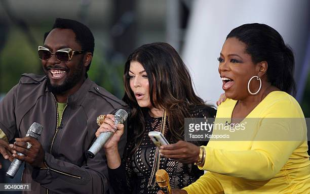 WilliAm and Fergie of Black Eyed Peas and Oprah Winfrey attend The Oprah Winfrey Show Season 24 Kickoff Party on Michigan Avenue on September 8 2009...