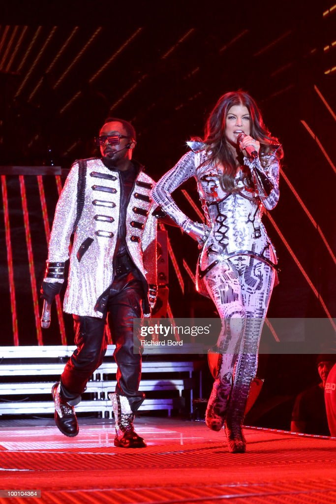 Will.i.am and Fergie of Black Eyed Peas perform live on stage during a concert at Palais Omnisports de Bercy on May 20, 2010 in Paris, France.