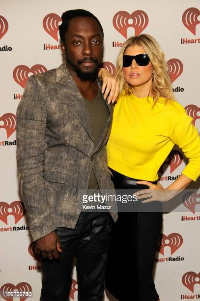 william and Fergie of Black Eyed Peas pose backstage at the iHeartRadio Music Festival held at the MGM Grand Garden Arena on September 23 2011 in Las...
