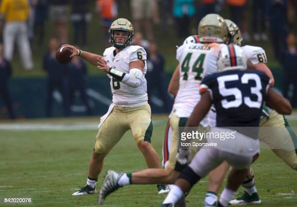 William and Mary Tribe quarterback Tommy McKee throws a pass from the pocket during the Virginia Cavaliers game versus the William and Mary Tribe on...