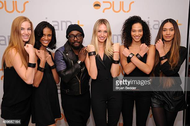 william and models pose with iamPULS to pump up holiday shoppers during black Friday at Bloomingdale's on November 28 2014 in New York City