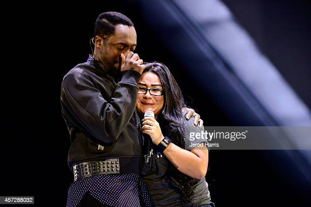 william and student app developer Cynthia Erenas share a moment on stage at the launch of iamPULS at Dreamforce 2014 on October 15 2014 in San...